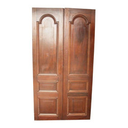Pre-owned Antique Hacienda Mahogany Doors - Photos do not do justice to these stunning 100+-year-old mahogany doors from a pre-turn-of-the century South American family hacienda. From a set of 30, these hand carved doors led from the grand family home to large inner courtyard and garden. They are all that was left standing after an earthquake destroyed the rest of the home. Gorgeous piece for a unique venue or home. These also make stunning dining and conference tables, as well as headboards.     There are 14 doors or 7 pairs, with 3 different finishes. Price listed is per door. If interested in purchasing multiple, please contact support@chairish.com.