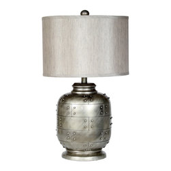 Hammered Silver Table Lamp - I love how this table lamp mimics an old airplane with the rivets, patina and lines. Don't overlook how strong accessories like this one can really make the design!