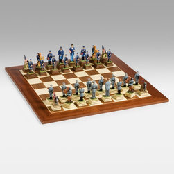 Cambor Games - American Civil War Chess Set - CB133 - Shop for Chess and Strategy from Hayneedle.com! Choose your side in the greatest war in American history with the Cambor Games American Civil War Chess Set. The realistic museum reproduction colors on the Oxo-Teak carved figurines will make your next chess match feel just like a reenactment of the Gettysburg battle. This set features the Union army dressed in blue and led by Abraham Lincoln (king) General Ulysses S. Grant (queen) on one side and the Confederate army in gray commanded by Jefferson Davis (king) and General Robert E. Lee (queen) on the other side. You decide who really won the war in your next match. You have a choice of three boards to give your special set the perfect playing field. The classic Spanish Board features 1.75-inch inlaid walnut and sycamore squares for a traditional look that will perfectly complement most chess pieces. The Champion Board was made in Spain from 1.75-inch inlaid walnut and sycamore squares and features a delicate inlaid mosaic border. The highly polished Spanish Inlaid Mosaic Board combines 1.75-inch maple and walnut squares with a striking ornate border. About Cambor GamesNew Jersey-based Cambor Games has spent the last 30 years developing product lines to address a variety of classic gaming needs. The company offers chess sets backgammon boards poker equipment dominoes mahjong tiles and more. From traditional designs to novelty themed items value-priced beginner sets to high-end collectors' dreams Cambor Games has the game equipment you need to have years of fun with close friends or bitter rivals.