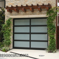 Contemporary Style Garage Doors in San Francisco Bay Area - Many contemporary style homes in San Francisco Bay Area are using full-view or glass and metal garage doors that offer many customizable glass types, frame colors and even panel arrangements that will give your home a custom feel with a contemporary garage door design that requires very little maintenance. Glass and steel garage doors were originally developed for industrial uses such as gas stations and store fronts. However, today's contemporary architecture has evolved with realism or futurism. where things are made to look futuristic. Ziegler Metal and glass garage doors are sleek in appearance and resemble a futuristic look into how garage does will evolve over time. We are consistently researching and designing new ways build garage doors that are ahead of there time. This includes very low maintenance, ease of operation and a almost quiet open & close feature. op and are sure to add the finishing touch to your homes contemporary design. Ziegler Garage Door can provide you with prices on your custom contemporary style garage door selections by calling (415) 505-8612. These custom-made glass garage doors our a contemporary style, you can select anything from clear anodized aluminum, dark bronze or black. In addition, custom powder coating can be done to get the exact color match desired. Glass options are almost unlimited. White Laminate is by for the most popular, but dark tinted, bronze laminate and even clear are viable options depending on what you're looking for. If you have converted your garage to a playroom, garage office, extra liveable space. These custom contemporary garage doors can make use of your San Francisco Bay Area Garage far more useful while adding square footage to your home in lieu of wasted garage space. If your home is located in the Bay Area and you're looking for a contemporary garage door that has low maintenance and need an upscale exterior appearance then these Full-View C