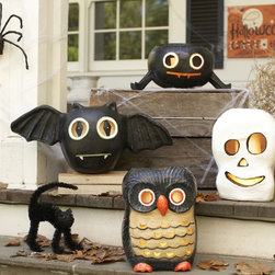 Halloween Luminaries - These papier-mâché luminaries from Pottery Barn Kids are different from the usual paper bag luminaries. Decorate your front porch with them to get ready for those trick-or-treaters.