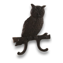 Cast Iron Perched Owl Wall Hooks - Give a hoot...hang the loot! This owl won`t mind if you hang your things from his perch! This wide eyed cast iron owl features two hooks on which you could hang keys, dipped candles or even bath towels! It measures 7 3/8 inches high, 5 3/4 inches wide and 1 inch deep. It has an appealing antiqued rust finish. It easily hangs on the wall through two pre-drilled holes in the perch. It would make a lovely gift, too!
