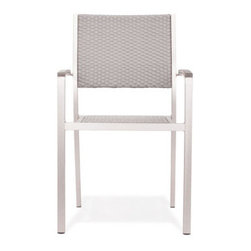 Grandin Road - Metropolitan Outdoor Armchair - Sleek collection with brushed aluminum frames. Select an Armchair, Slatted Armchair, Side Chair, Bench, and Dining Table; each piece is sold separately. Armchair features teak wood armrests. Armchair and Side Chair feature woven seats and backs. Slatted Armchair offers a teak wood seat and back slats. Introduce the modern lines of our Metropolitan outdoor dining Collection to your porch or patio. Versatility abounds with four seating options to surround the teak-top table.Natural teak details and woven seats and backs add extra warmth to the brushed aluminum frames.. . . . . Dining table and bench have slatted teak tops. All pieces arrive assembled. Clean surfaces with a dry cloth, teak with wood cleaner. Imported.