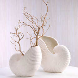 Sand Stone Nautilus Shell Vase - 16 x  11 - For those who adore a coastal or sea themed d�cor, the Sand Stone Nautilus Vase is an ideal accessory to add to your collection. The Nautilus inspires a serene feeling - soft waves lapping at the shore and a slight breeze brushing against the cheek. Bring the oceans majestic Beauty indoors and use this vessel for a few branches of driftwood or perhaps an indoor plant will nestle nicely inside showcasing the vase perfectly.