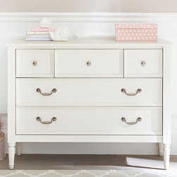 Blythe Dresser - Paneled drawers framed with signature molding reveal the artistry in our casual dresser. It's accented with contrast drawer pulls and spindle-turned feet.