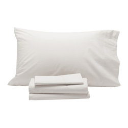 """Coyuchi - Sateen Sheet Set Twin White - Lustrous on one side, slightly matte on the other, our organic cotton sateen is loomed to a 300-thread count in a buttery sateen weave that resists wrinkling. An elegant 7"""" attached hem finishes the flat sheet and pillowcases, while the fitted sheet has a deep 15"""" pocket and full elastic for an easy fit on plush mattresses."""
