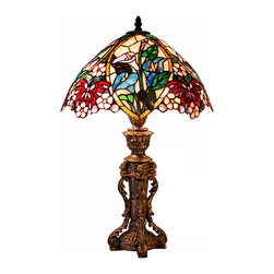 Warehouse of Tiffany - Tiffany Style Flower Design Table Lamp - This vibrant and intricately designed floral tiffany table lamp adds a touch of classical sophistication to a room. The bronze base gives a stately presence to the lamp. The stained glass has gorgeous butterfly and flower designs throughout.