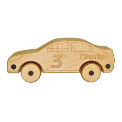Jett - Wooden Race Car - Vroom, vroom, vroom! This wooden race car is ready to race into your home and all over your counters, kitchen table, little brothers and sisters and every other place in your home where you'd like your little one to not play. It's okay, Jett works just as well on the floor! You pick the number and name and we'll take care of the rest.