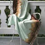 """Fern Merino Pale Blue Throw Blanket 52"""" X 74"""" - With perhaps the longest and most storied history of any color trending with today's decorators, the solid pale blue of this light, luxe merino throw offers a versatile addition of the popular bird's-egg tint.  Its interpretation, however, is fresh as morning dew: a lush pattern of brown fern leaves, fading from chocolate at the base to fawn at the tips, deeply patterns opposite borders of a blanket made for folding and draping in an inviting space."""