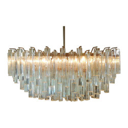 Large Venini Camer Glass Chandelier - If money were no object, I would add a few of these vintage Italian numbers to my house. The glass prisms in this handblown Venini chandelier perfectly bounce the light around to create incredible patterns in the ceiling. It looks as good in a master bedroom as it does in a dining room.