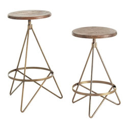 Wyndham Wood/Iron Swivel Barstool - Enjoy the simple, geometric architecture of the Wyndham Swivel Barstool, whether you're appreciating the way the lines accentuate a counter island or poised on the distressed, perfectly round seat. Tube-shaped iron legs with a warm and mellow natural brass coloring are bent to form three feet, but continue up to join in the circling footrest ring, creating an attractive continuous look in a barstool where form exquisitely follows function.