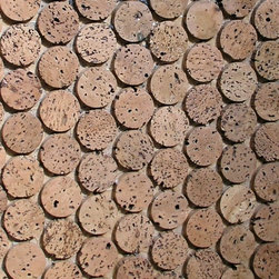 "Round Cork Mosaic Tiles - Round Cork Mosaic Tiles are a versatile, extremely durable, environmentally friendly material made from 100% post-industrial, granulated, and pressed cork by product from the Portuguese wine cork industry. These distinctive 1 inch cork disks ( think of 1/4"" cut wine stoppers) are then affixed to 12×24 inch interlocking sheets for easy installation like any standard tile. These tiles are in their natural state and can be stained any color or used in wet applications by adding water based polyurethane to the final installation. Cork is a natural thermal insulator with great acoustic properties which are just a bonus to this very good looking distinctive tile. Whether it's commercial or residential, wet or dry, floors or walls, cork mosaic tiles are the do anything and always look stunning tile choice."