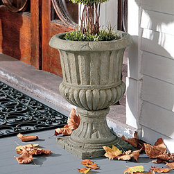 "Improvements - Fluted Urn - Each garden urn comes with two pot rings to keep a potted plant from shifting. These stylish garden urns can also be used for direct planting: simply fill with soil and add your own annuals or a small shrub. Use any of these stylish garden urns to add an elegant look to your entryway or patio or porch. Our Topiary Urns are the ideal way to show off one of our topiaries, or use them for direct planting. These stone-look garden urns are custom-sized to hold any of our life-like topiaries to create a look of classic elegance, outdoors or in. You can also add garden soil to the urns to grow live plants or small shrubs. Made of weather-resistant resin, the Topiary Urns can be left outside year round, plus they're suitable for indoor use, too! Each urn includes 2 interchangeable metal pot rings to hold a pot that's 7"", 8"" or 10"" in diameter. Choose from assorted styles. The Fluted Urn provides old-world elegance with a classic distressed fluted design on a square base. The urn is light green clay in color with slight hints of a darker green color for a moss effect. The Square Urn makes a simple yet bold statement with its stone-look design in your choice of 2 finishes. The Leaf Urn (greystone finish) is beautifully shaped with an acanthus leaf motif and pedestal base. Classic Swirl Urn (rustic brown) has a swirl design and pie crust rim to add a sophisticated look to your entryway. patio or porch. The Leaves and Berries Urn (black with rubbed red undertones) features a graceful embossed design and fluted detailing. Ivy Urn (Bordeaux red) features a vining design around the top and pedestal base.Benefits of the Topiary Urns:  See our complete selection of Topiaries & Artificial Plants."