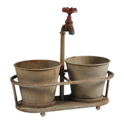 "Rusty Faucet Planter - With its deep patina, this planter looks like it led an interesting life before reaching your home. The attached (nonworking) faucet handle adds vertical interest, but it's also ready to support a climbing plant. Holds two 3"" plant pots for double duty."