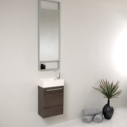 "Fresca - Pulito Small Modern Bathroom Vanity w Tall Mirror in Gray Oak - Single Hole Faucet Mount. Soft Closing Door. P-trap, Faucet, Pop-Up Drain and Installation Hardware Included. With overflow. Sink Color: White. Finish: Gray Oak. Sink Dimensions: 11 in. x7 in. x3.75 in. . Mirror: 15.75 in. W x 47.75 in. H x 2 in. D. Materials: MDF with Acrylic Countertop/Sink with Overflow. Vanity: 15.5 in. W x 8.5 in. D x 24.75 in. HInnovative design and economical in size makes this ECO friendly vanity ideal for any smaller location, perfect for going ""Green"". Anyone is sure to complete their space with guaranteed cutting contemporary chicness. Finally! A vanity ensemble that gets you in and gets you out into the world with style! A winning combination is complimented with an extra long vertical mirror and included faucet."