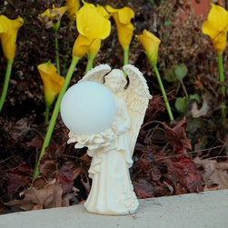 Flipo - Solar Resin Angel Light Multicolor - SOL-GLO-ANGL-LG - Shop for Lighting from Hayneedle.com! Who has a garden or patio that couldn't use a bit of angelic twinkling from the Solar Resin Angel Light? This resin light features a delicate angel holding an opaque globe housing LED lights that shift through a spectrum of colors and are powered by a single rechargeable battery (included). The battery is charged via a single solar panel at the back of the light allowing you to have reliable clear light every night. This weatherproof outdoor light is designed to resist moisture.About Flipo GroupAnyone can imitate; a select few innovate. Located in La Salle Ill. Flipo Group offers a wide variety of products ranging from decorative home accents to solar products and useful devices. They specialize in products that use LED technology. After 12 years of product innovation Flipo Group continues to pride itself on the ability to bring imaginative and inventive goods to market - first.