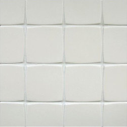 Clodagh Shield 4 x 4 Tile - The soften edges of this concrete tile makes the negative space of your grout lines just as interesting as the tile itself.  The gentle pattern creates such a warm and welcoming effect.
