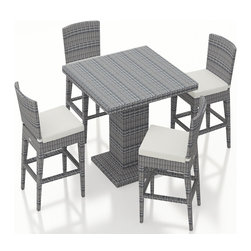 Harmonia Living - Urbana 5 Piece Weathered Stone Wicker Bar Set, Canvas Natural Cushions - The Harmonia Living Urbana 5 Piece Outdoor Bar Set with White Sunbrella Cushions (SKU HL-URBN-WS-5BCS-CN) with Resin Wicker will add style to any back yard, balcony, or outdoor space. The set's compact, minimalist design can fit your guests into small areas without compromising its contemporary look. The table and four stools are covered in a modern, High-Density Polyethylene (HDPE) wicker infused with a Weathered Stone color and UV protection, designed to last despite harsh outdoor elements. Each piece is framed with powder-coated, thick-gauged aluminum for strength and excellent corrosion resistance. The seats feature additional reinforcement to prevent the resin wicker from stretching over the life of the stools. Conveniently, underneath each piece are plastic guides to let you slide the seats or rearrange this patio dining set freely without worrying about damage to your patio or deck.