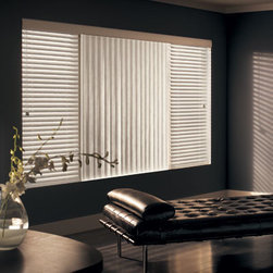 Graber Vinyl S-Curve Vertical Blinds - Graber Vertical Blinds add clean, linear styling to your windows. A sophisticated window treatment that gives patio doors and large windows drama and dimension while maintaining privacy and light control. All vertical headrails backed by a limited lifetime warranty. Durable room darkening vinyl louvers are available in neutrals, colors and textures to complement any decor. Room-darkening S-Shaped louvers combine the appearance of a soft drape with the durability of vinyl.