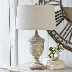 """Regina Andrew - Regina Andrew Lighting Gesso Wood Vase Table Lamp - Regina Andrew Design marries vintage style with modern flair for a home collection that's truly timeless. This gesso wood vase table lamp base offers a rustic accent in a living room or bedroom. Its carved, weathered base is topped with a neutral oatmeal drum shade. Lamp measures 18"""" round x 29""""H."""