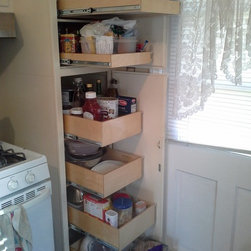 Pull Out Pantry Shelves - Create the ideal with pantry with custom pull out shelves from ShelfGenie of Connecticut.  Combine single-height, double-height and sloped pull out shelves.