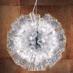 AXO Light - Blum Suspension by AXO Light - The AXO Light Blum Suspension was designed by Marcello Furlan to be a bouquet of light. As a contemporary and organic take on a Venetian chandelier, numerous bloom-shaped glass shades are clustered around the central light source, gleaming and refracting light with their naturalistic folds of blown glass. Available in two sizes and in either crystal or a strikingly luminous chrome-plated glass. Italy's AXO Light combines traditional Venetian glasswork and artisan craftwork with avant-garde lighting techniques and innovative materials. Their design philosophy is clear: use creativity and inspiration to create stunning lighting replete with value and emotion.