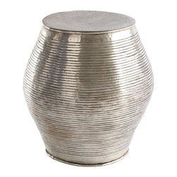 Brass Indian Stool - Let this shiny brass Indian stool add a bit of spark to your living room, bedroom or anywhere you need to drop anything — from a drink to your bum. This is an extremely versatile piece that will blend in virtually anywhere.