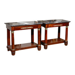 Consigned Empire Consoles - These impeccable Empire console tables — from France, circa 1810 — bring a regal touch to your favorite formal space. Crafted of mahogany with extraordinary black and white marble tops and gilt bronze details, the pair makes an important addition to your antiques collection.