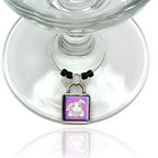 """Made on Terra - Bunny Rabbit Wine Glass Silver Charm - Your guests have arrived and the atmosphere is electric. A sip of wine here, a sip of a cocktail there and you find the conversation turning to the charming baubles you've placed on the glasses, something special you chose for each of your eclectic guests. They love them and appreciate your thoughtfulness. You love them for their uniqueness and that no one forgets which glass they were using.  Choose from Made on Terra's many designs for the best party ever. Ring is 1"""" diameter; measures 2"""" from top of ring to bottom of charm. Made of metal and plastic. Sold individually."""