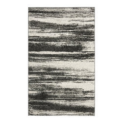 Safavieh - Retro Gray Area Rug RET2693-8479 - 8' x 10' - Safavieh channels the Sixties with Retro Shag, a cool new spin on the essential floor covering of mid-century modern style. The perfect complements to clean-lined furniture of the period, these chic black and white designs morph into tones of gray, silver and ivory in patterns from Pollack-inspired abstracts to contemporary graphics. Machine-loomed in Turkey of 100 percent polypropylene, our low-pile Retro Shag rugs combine beauty, easy care and outstanding performance.