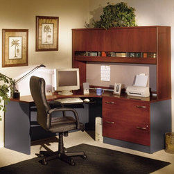 Bush Furniture - Bush Series C Corner Desk and Hutch with Lateral File - BHI449 - Shop for Desks from Hayneedle.com! The Bush Series C Corner Desk and Hutch With Lateral File functions as a right return on your standard desk. The top surface is scratch- and stain-resistant and the corner module has desktop and modesty panel grommets for wire access and management. Durable PVC edging protects the desk from daily bumps and collisions.The hutch provides ample storage space with four cabinets so you can keep your office organized and tidy. European-style self-closing adjustable hinges help keep cabinet door movements smooth and the doors closed. Thoughtful touches make this hutch an attractive addition to your workspace: its back panel is fully finished and a convenient fabric-covered tack board is ideal for notes and messages.The lateral file cabinet is perfect for storing your letter legal and A4 files. The drawers open on full-extension ball-bearing slides for smooth movement and the single gang lock has an interchangeable core that affords privacy and versatility. Interlocking drawers reduce the likelihood of tipping and levelers provide stability on uneven floors.Each piece in this beautiful package is finished in your choice of beautiful wood tones and includes a 10-year manufacturer's warranty. Choose from mahogany mocha cherry auburn maple light oak natural cherry or Hansen cherry finish. This product meets Business and Institutional Furniture Manufacturer's Association (BIFMA) standards for safety and performance. Assembly required.About Bush FurnitureBush Furniture is the eighth-largest furniture company in the United States. Bush manufactures high-quality products which are designed to be easily assembled and provide great value for the price. Bush furniture is made from a combination of particleboard fiberboard and solid wood components. The use of real wood components will be noted in the product description if applicable.Bush Industries has more than 4 million square feet of manufacturing warehousing and distribution space. This allows for a very wide selection of high-quality furniture with the ability to ship quickly. All Bush Furniture is also backed by a 10-year warranty from Bush one of the best in the industry.Hutch overall dimensions: 70.984W x 15.354D x 42.992H inchesOverall lateral file cabinet dimensions: 35.669W x 23.346D x 29.842H inchesUpper drawer compartment: 31.81W x 15.2D x 10.83H inchesLower drawer compartment: 31.81W x 15.2D x 11.26H inchesCorner module dimensions: 70.984W x 35.472D x 29.842H inchesPlease note this product does not ship to Pennsylvania.