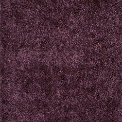 "Flux FL18 Rug - 3'6""x5'6"" - Personal expression reaches new heights with Flux, a beautiful range of plush, hand-woven shag rugs of 100% polyester. This ��_chameleon��_ is ideal for the contemporary design lover who enjoys mixing up his or her personal space often ��_ acting as a rich background to a diverse palette of furnishings and accessories. Highly textured shag construction brings comfort underfoot while a palette of fashionforward solid hues commands attention in any room."