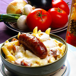 Calzphotography - Create your style - This is a meal of rigatoni and Italian sausage garnished with cheese,enjoy the feast.