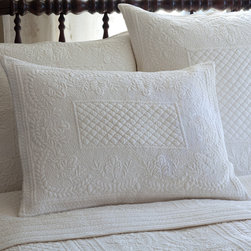 Taylor Linens - Abigail Cream Standard Sham - This sham will rise to the top of your list and your bed. Intricately quilted diamonds, rectangles, leaves, wreaths, dots and other shapes provide textural interest on the cotton percale. It's also completely machine washable so you can rest easy for sure.
