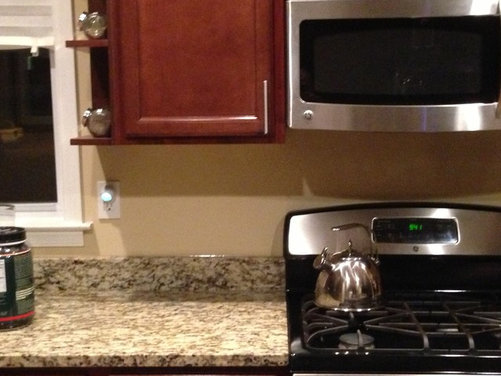 have a very busy granite counter top with classic brown rouge