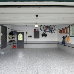 Garage Organization - Forget the cars, this beautiful garage has more than enough room to serve as additional space for parties and the occasional family get together. And when it's raining outside, the kids have a space to run around. This garage was also featured in the local Parade of Homes.