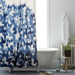 Mariposa Shower Curtain - This shower curtain looks almost like a piece of artwork. The blue butterflies are so pretty, and I would definitely love to use them in my bathroom.