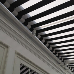 Retractable Awning Black & White Stripe - Executed by Breslow Home Design. www.breslow.com