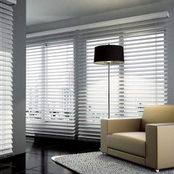 "American Blinds Signature Wood Blinds in True White - Signature Wood Blinds by American Blinds are offered in 1 3/8"", 2"", and 2 1/2"" slat sizes, and are available in a beautiful range of painted and stained finishes. They're made from genuine basswood, and feature distinctive wood grain and a protective UV resistant finish. The trapezoidal bottomrail ensures better slat closure. Upgrades include ladder tapes, loop control, rounded corners and routeless slats."