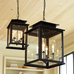 Ballard Designs - Calisse 4-Light Lantern - Antique bronze finish. Cream drip candle sleeves. Outdoor Safe. A classic choice to use over a table, in an entry hall or stairwell, this four light lantern offers a big look for a surprisingly small price. The tiered top and clear glass panes recall the romantic candlelit lantern fixtures of the 19th century. Hinged glass panel door is in keeping with the classic lantern look. Open bottom allows extra light to shine through. Calissse Pendant features:. . .