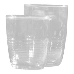 Recycled Glass Tumbler - 8 oz. - The Recycled Glass Tumbler Large recalls the mid-century modern aesthetic that lent an oh-so-cool vibe to gatherings where the silken sounds of Count Basie played on the stereo and smooth libations were imbibed. Made of recycled glass, the tumbler boasts a tinge of blue and a subtle ribbed detail on the bottom half of the glass.
