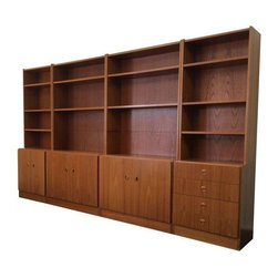 "Pre-owned Mid-Century Style Danish Teak Modular Wall Unit - Beautiful and substantial wall unit in teak. An excellent solution for your office of library. This set is on wonderful vintage condition, ready to display your books and treasures. Four bays in total, two measuring 24"" w and two measuring 36"" wide for a total of 120"" long."
