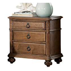 American Drew - American Drew Grand Isle 3-Drawer Nightstand in Amber - The Grand Isle collection is a lifestyle bedroom and dining room group that offers high end, yet casual up to date tropical style with multiple options for any room of the home; creating a collection that is perfect for many homes, vacation homes or even smaller size vacation condos. The amber finish has a warm overtone with subtle dark burnished accents that make the natural soft distressing show through. Design elements used in Grand Isle include carved and shaped pilasters, woven drawer fronts and a louver motif; all adding a higher end look to the collection. This collection is sure to add a relaxed, yet sophisticated style to most homes and offers plenty of options to help with storage and organization.