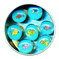 "Fish Glass Gem Magnet Set - This adorable set of Fish magnets is handmade in our studio. Our glass gem magnets started with tiny paintings and then reproduced. Each one is then sealed under a clear glass gem and attached to super strong ceramic magnets, so they're not only cute, they're functional. (Not like those magnets that fall off when you close the refrigerator door!) Each magnet is about 3/4 inch wide, the tin is 2.75"" wide. Set of 7 in a tin. Made in the USA."