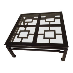 Pre-owned Ming Regency Style Coffee Table - A vintage Chinese Ming lacquered coffee table with beautiful fretwork. Great left as-is for a Chinoiserie chic look or painted a bright new color for a Palm Beach regency look. Overall the black glossy finish is in excellent condition with a few minor scratches from normal wear. The top comes with four square beveled glass inserts that are removable.