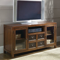 """Hammary - Mercantile Entertainment Console Table in Whiskey Finish - Hammary's Mercantile series is crafted of Poplar Solids and Cherry Veneers, Metal and Beveled Glass with a Whiskey finish. The collection is reminiscent of general stores and Early 20th Century styles, the look of this grouping is sure to add a nostalgic and casual feel to any home.; Mercantile Collection; Finish: Whiskey; 2 Glass Front Doors with 1 Adjustable Shelf Behind Each; 2 Drawers - Top Drawer is Drop Down for Component; 1 Open Compartment: W20 1/2 D17 3/4 H6 1/2; Weight: 146 lbs.; Dimensions: 54""""W x 18""""D x 28""""H"""