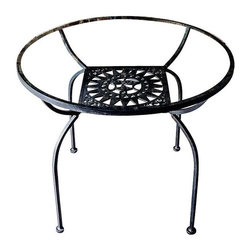 Arthur Umanoff Mayan Sun Table - A whimsical masterpiece for a patio, a terrace or simply on wood floors. Round 1960s steel frame table with sun design made by Arthur Umanoff. Glass table top has some light scratches and the table has normal age-related wear. Matching 6 chairs set available offered separately.