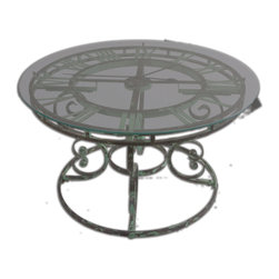 """Uttermost - Gilbertine Clock Table - You'll never have to ask, """"What time is it?"""" if you have this handsome coffee table in your space. The antiqued scrolled, green wrought-iron base is topped by an honest-to-gosh, working clock under clear glass. You'll love the rich look it brings to your living space."""