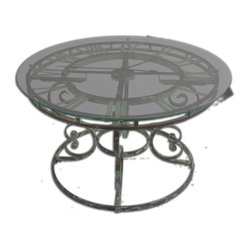 "Uttermost - Gilbertine Clock Table - You'll never have to ask, ""What time is it?"" if you have this handsome coffee table in your space. The antiqued scrolled, green wrought-iron base is topped by an honest-to-gosh, working clock under clear glass. You'll love the rich look it brings to your living space."