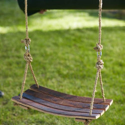 "Viva Terra - Barrel Stave Swing - After aging premium wines, authentic American and French oak wine barrels get a whimsical make-over.  Four staves become a unique suspended seat.  Kick off your shoes and swing awhile.  Base ropes included, but hanging ropes are not.  23""L x 13.5""W"